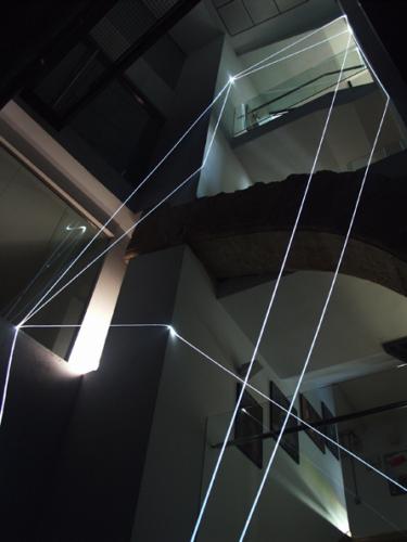 16 CARLO BERNARDINI, PERMEABLE SPACE 2008; Fiber optic installation, feet h 44x11x9. Valencia, La Nau - Universidad de Valencia.