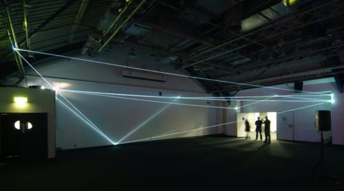 25 Carlo Bernardini, Drawing of the Vacuum 2011, optic fibers installation, feet h19x74x37. Kinetica Art Fair, Prewiew - The Arc Show, Business Design Centre, London.