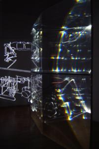 13 CARLO BERNARDINI, FANTASMA DI DUCHAMP 2009, Fibre ottiche, plexiglass, superficie OLF e videoproiezione, cm h 262x138x40; Museo d'arte, Villa Ciani, Lugano.