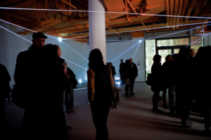 24 Carlo Bernardini, Vacuum 2011; installazione in fibre ottiche, mt h 4x16x14. Delloro Arte Contemporanea, Berlino.