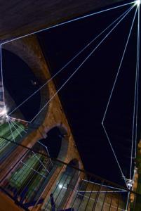 26 Carlo Bernardini Traiettorie Orbitali, 2016 Installazione in fibra ottica, h mt 6 x 10 x 15. Como, Palazzo del Broletto